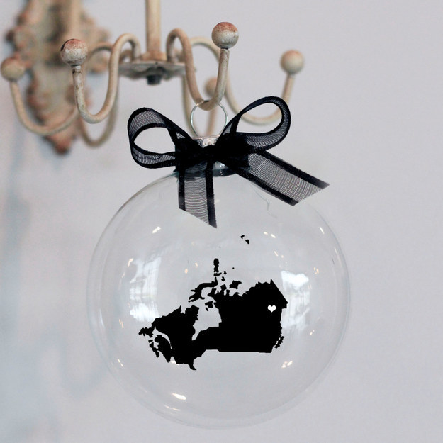 Hang a glass ornament that shows off your hometown this Christmas.