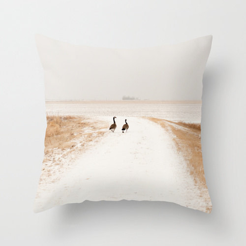 Cozy up with this elegant Canada Goose pillow.