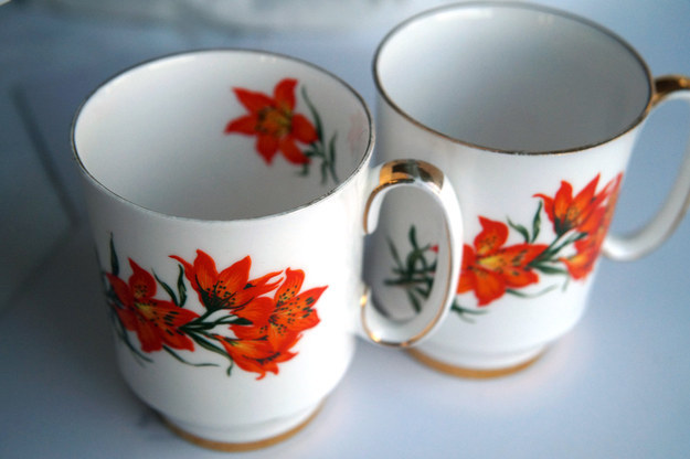 Sip coffee out of a mug covered in beautiful prairie lilies.