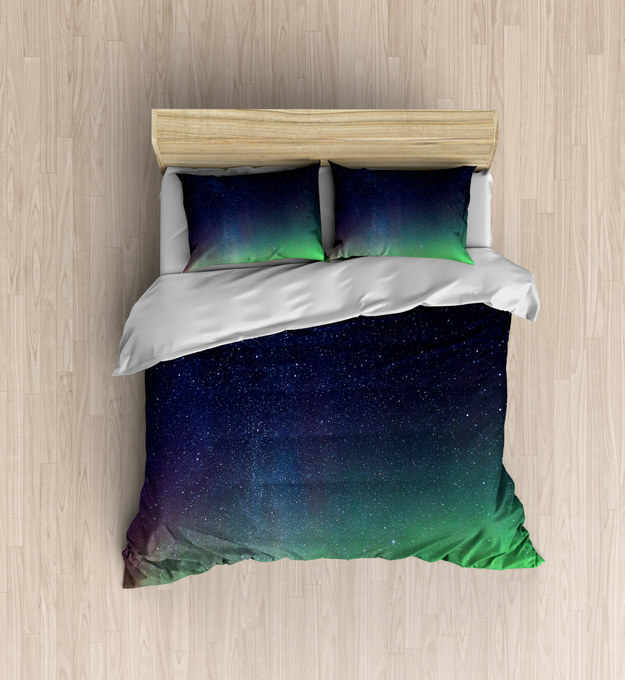 Sleep under the stars with a duvet cover that will remind you of the Aurora Borealis.
