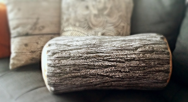 Throw a wooden log pillow on your couch.