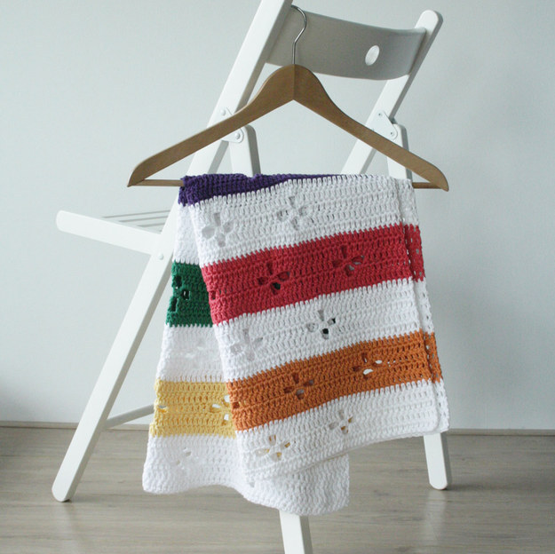 Keep your little one warm in a crochet baby blanket with a classic Canadian pattern.