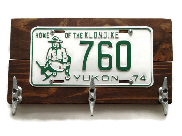 Hang your coat on this rustic coat rack made from an old Yukon license plate.