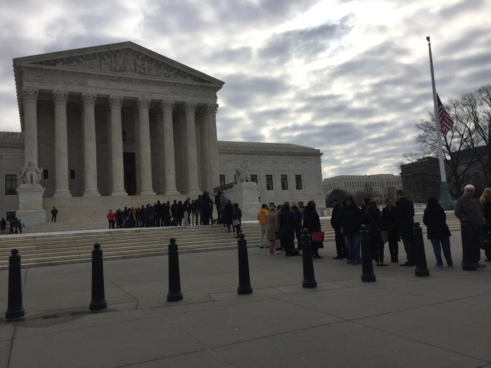 People wait in line outside the Supreme Court building before oral arguments on Monday, February 22, 2016.