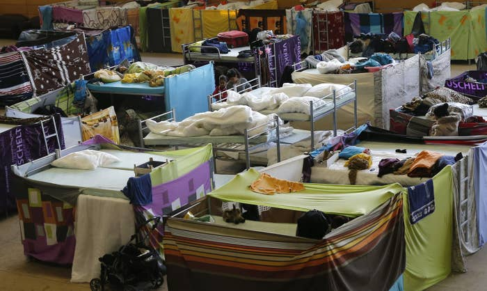 Beds stand inside a refugee shelter in Germany.
