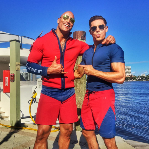 And by good I mean super hot fire because ladies and gents, The Rock and Zac Efron are here to save us.