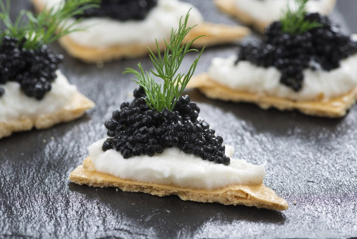 This looks eggsceptional. Spread some creamy cheese on a cracker and top with black caviar for the fancy goodness.