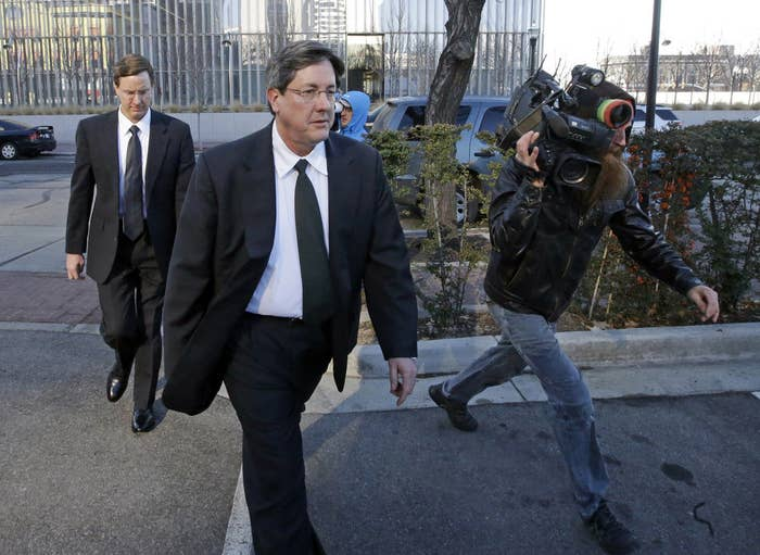 Lyle Jeffs, center, and his brother Nephi Jeffs, left, leave a federal courthouse in Salt Lake City on Jan. 21, 2015.