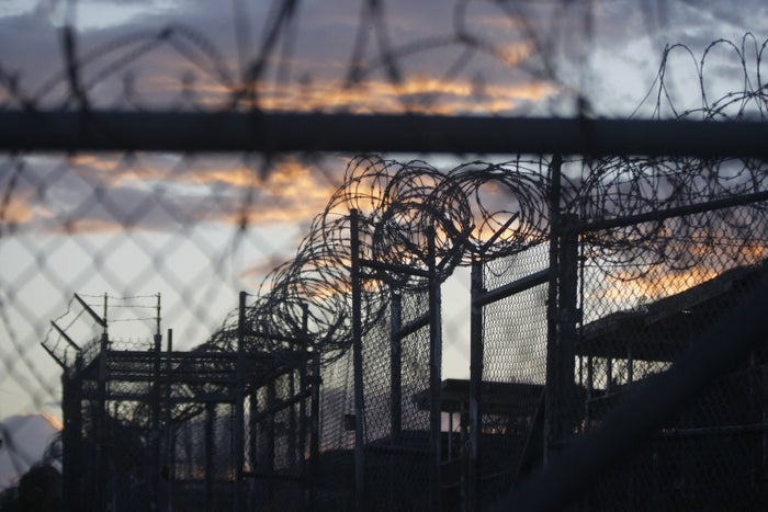 In this Nov. 21, 2013 file photo reviewed by the U.S. military, dawn arrives at the now closed Camp X-Ray, which was used as the first detention facility for suspected militants captured after the Sept. 11 attacks, at the Guantanamo Bay Naval Base in Cuba.