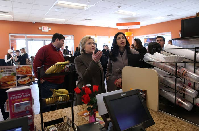 Hillary Clinton and aide Huma Abedin at a Dunkin Donuts on February 7, 2016 in Manchester, New Hampshire.
