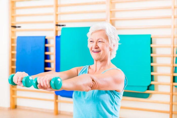 Senior woman doing fitness sport in gym