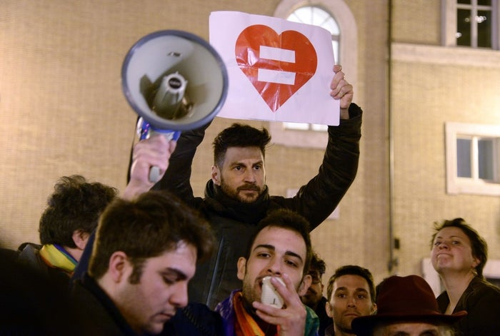 Supporters of same-sex civil unions demonstrate in Rome during the vote at the Italian Senate