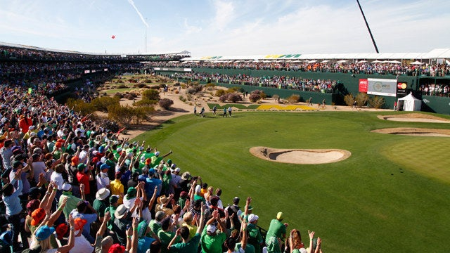 """You thought MLB, MLS and NFL have raucous crowds? During a round of the PGA TOUR's Waste Management Phoenix Open at TPC Scottsdale, a total of 201,003 spectators were shouting from the top of their lungs. Wait, what?!? Yes, the par-3 16th hole has been dubbed the """"loudest hole in golf."""" Beer cans were launched onto the green from the stadium surrounding the hole when a robot knocked in a hole-in-one earlier in the week."""
