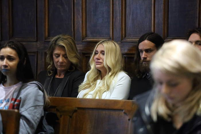 Kesha cries as she learns she will not be released from her record label contract.