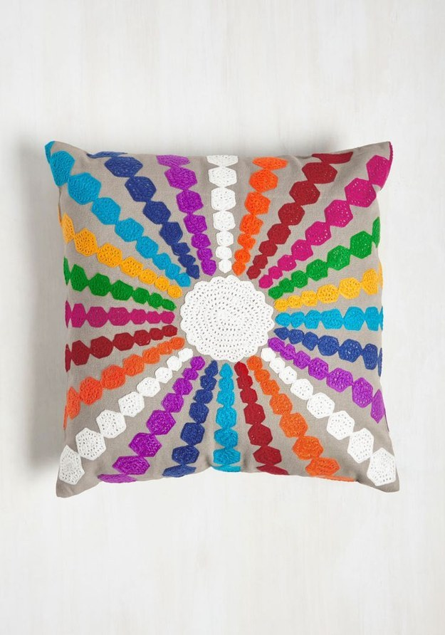 This pillow with colorful rays.