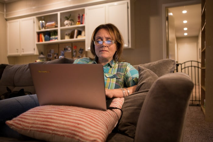 Lisa Bedford, the Survival Mom, at work on her computer at her house near Houston, Dec. 4, 2015.