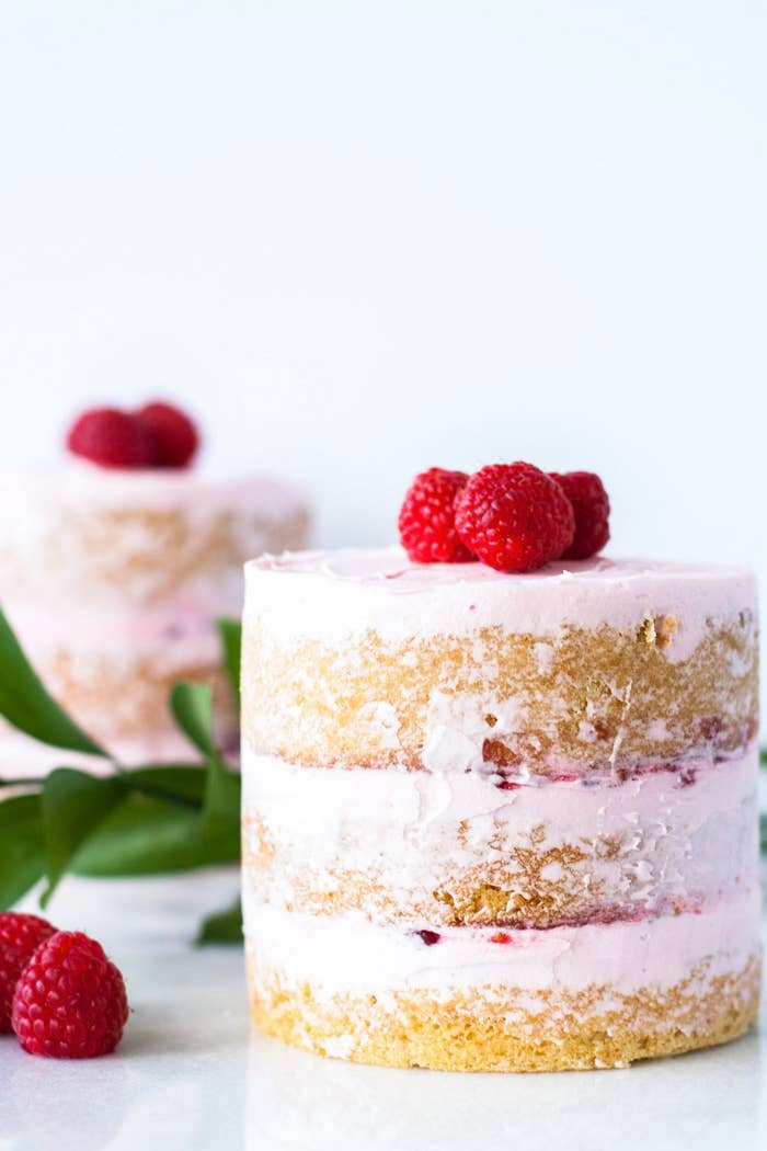 A buttery cake with a creamy vanilla frosting, layered with raspberry jam. Get the recipe!