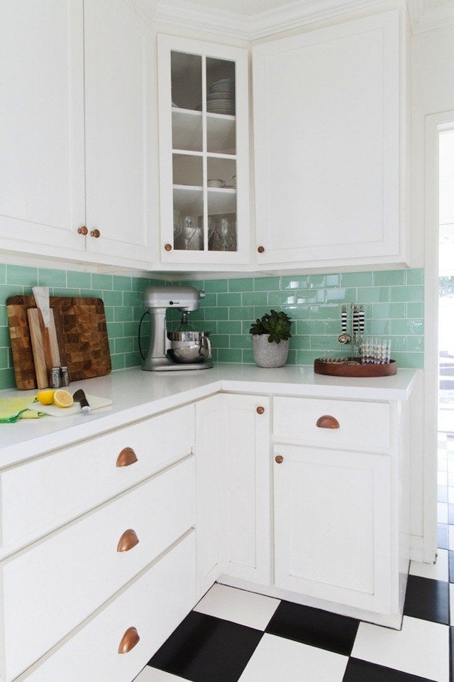 In this gorgeous before and after, they also updated the backsplash. But the painted knobs really make the kitchen seem ~finished~.