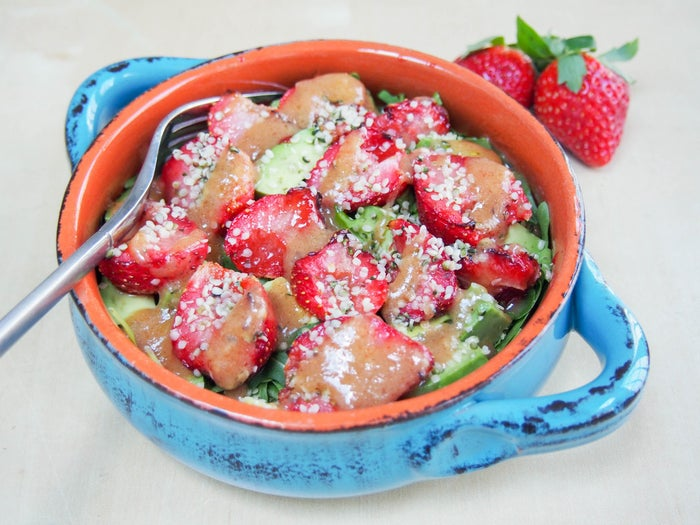 Roasted strawberry salad with tangerine-hatch chili dressing