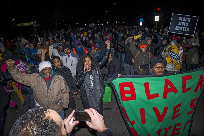 Mica Grimm, center (carrying microphone), a member of Black Lives Matter, leads a march from a makeshift memorial for Jamar Clark on the side of Plymouth Avenue several blocks from the 4th Precinct November 20, 2015, in North Minneapolis, Minnesota.