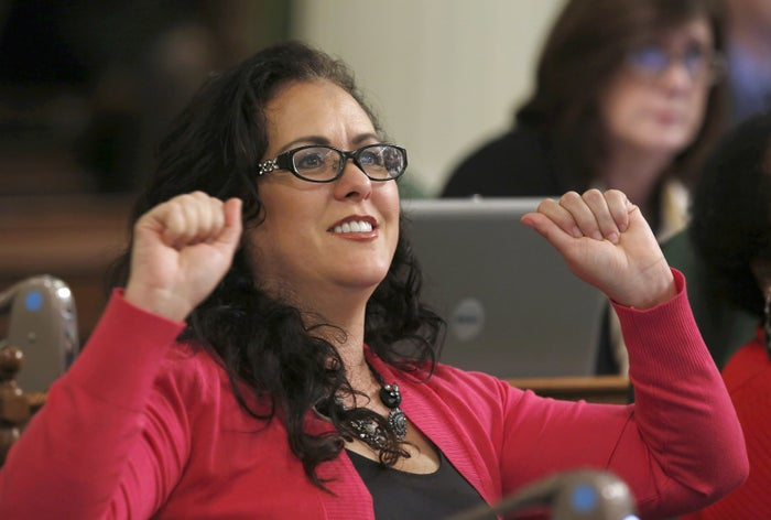 Assemblywoman Lorena Gonzalez celebrates after the bill is approved in March.