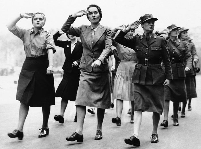 Canadian recruits for the Mechanized Transport Corps are shown saluting on parade after arriving home from overseas, September 10th, 1941.