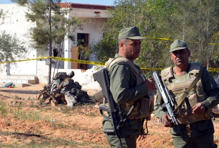 Tunisian soldiers stand guard at the scene of an assault on a house outside the town of Ben Guerdane