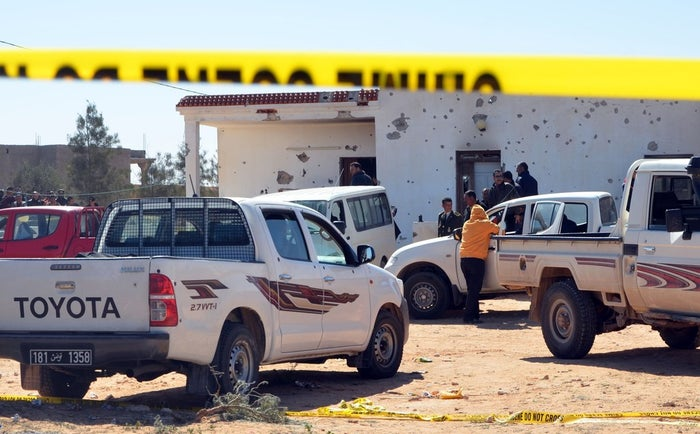 Tunisian security forces gather at the scene of an assault on a house outside the town of Ben Guerdane