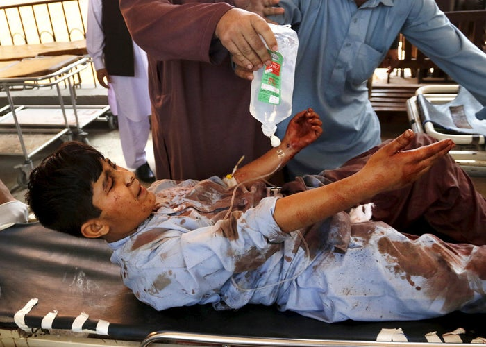 A boy injured during a suicide attack in Shabqadar, Pakistan, is transported on a stretcher at Lady Reading hospital in Peshawar.