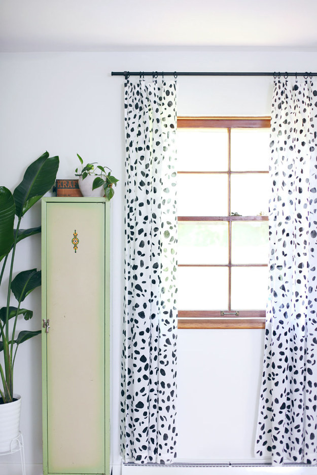 Upgrade your plain white curtains with a simple paint job.