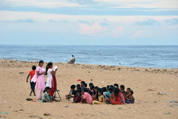 Fishermen's children sit through a Bible reading class on Marina Beach.