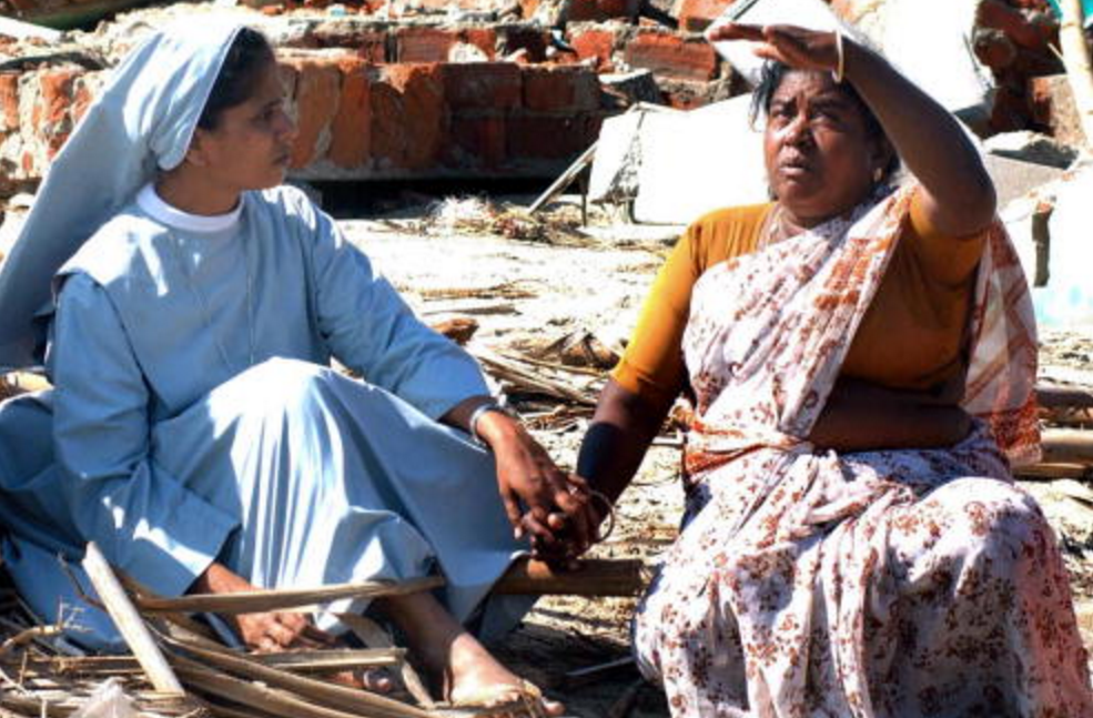 A nun sits with 2004 tsunami survivors in the weeks after the calamity, lending a hand, an ear, and a shoulder.