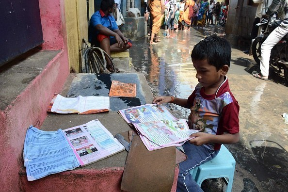 After severe floods, a boy salvages his most valuable possessions – his school books.