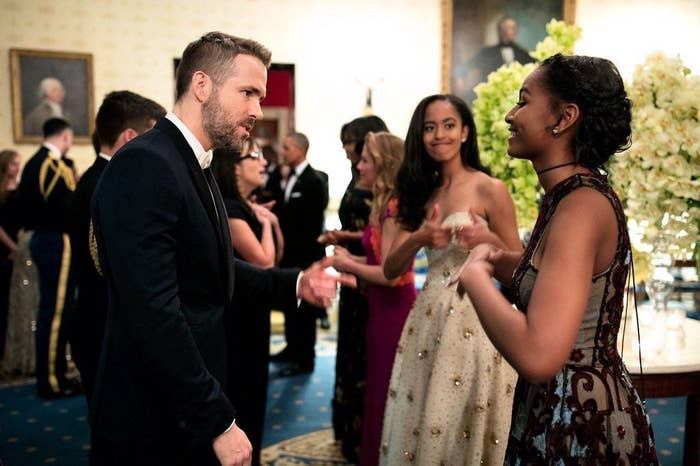 Here is Sasha Obama, 14, meeting Canadian actor and complete hottie Ryan Reynolds while her sister Malia, 17, watches on.