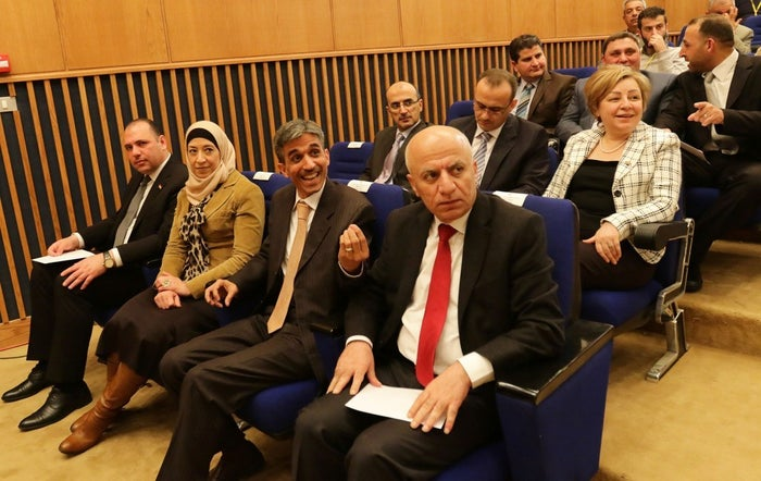 Members of the Syrian government delegation who will attend the Geneva peace talks.