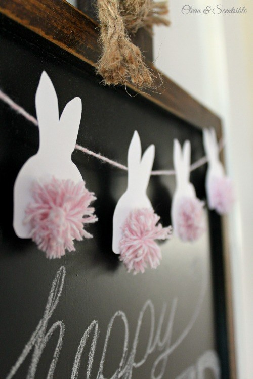 Cut out some cute bunnies, glue pom poms on their little behinds, and turn them into bunting.