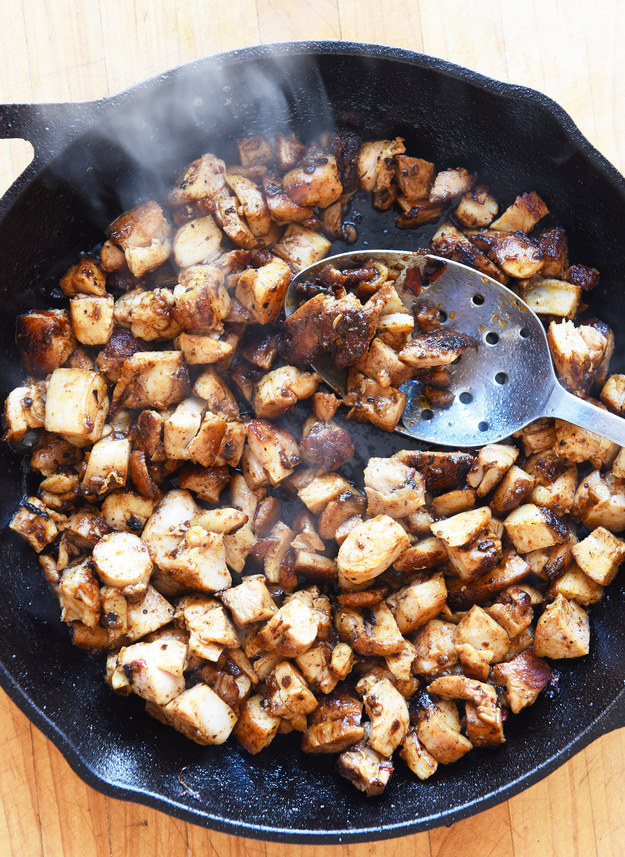 Return all the chicken to the skillet and cook it over medium-high heat until the little bits of chicken get all evenly coated and browned in the chipotle marinade, just a few minutes.
