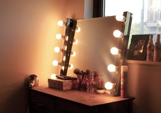 Check out how to make your own lighted mirror here.