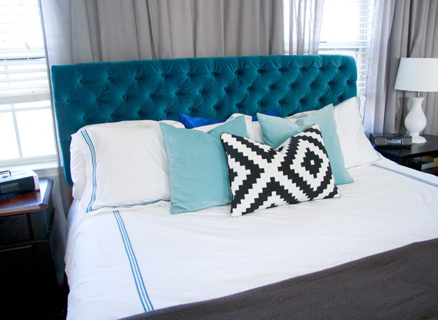 Nothing says glam like a velvet tufted headboard.