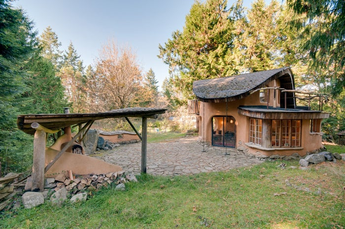 """The cottage is located on an acreage """"with sheep, gardens and orchards,"""" according to the description."""
