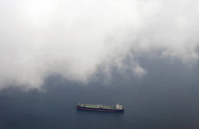 A tanker travels through the Singapore Strait July 7, 2014.