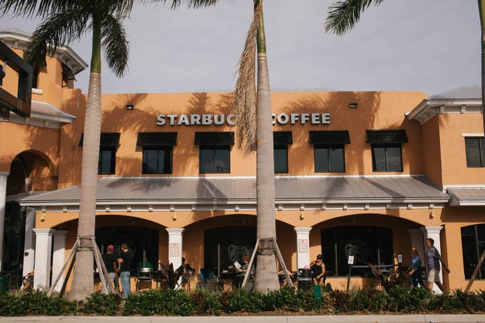 Outside of Starbucks Coffee on the busy street of Atlantic Avenue in Delray Beach, Florida. This coffee shop is a popular hangout spot for the rehab community.
