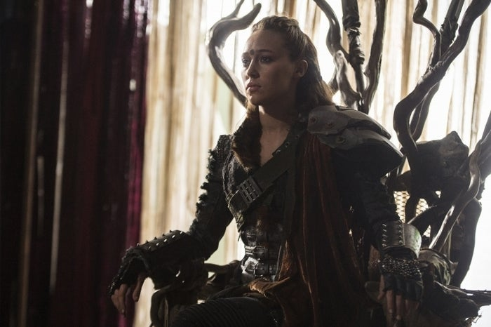 On March 3, CW's The 100 saw the death of Lexa (Alycia Debnam-Carey), the strong-willed, level-headed, badass Commander of the 12 Clans… who just happened to be a lady who loves ladies. Instead of giving her an honorable exit fit for a feared and respected Commander, Lexa was shot by a stray bullet meant for her lover Clarke (Eliza Taylor), mere minutes after the two consummated their relationship. Seriously. After what is arguably one of the tenderest make-out sessions/post-coital cuddling in the history of television, the next scene found Lexa struggling to breathe with a bullet in her abs as Clarke desperately tries and fails to patch her up.