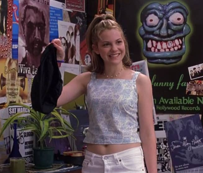 '90s points for her crop top, but the white jeans fit way too well