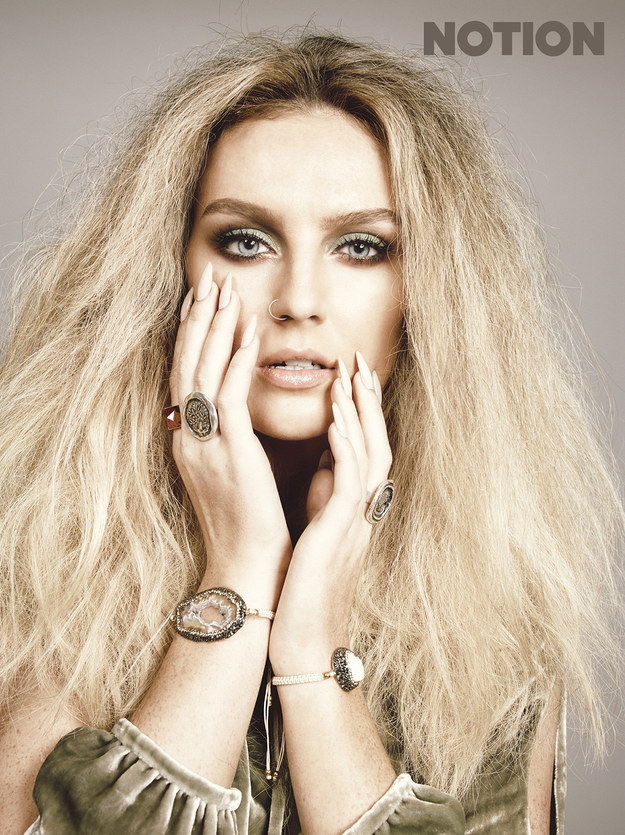 Look at Perrie's magnificent face.