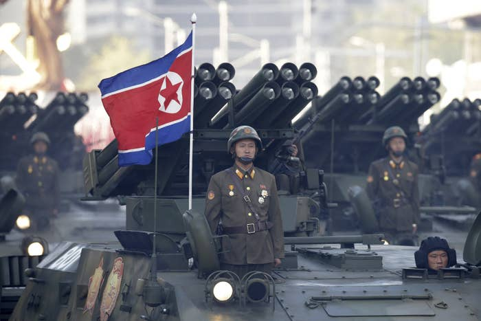 North Korean soldiers stand on armored vehicles with rocket launchers as they parade in Pyongyang, North Korea