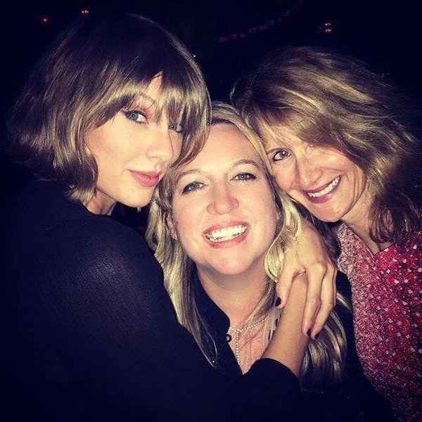 Here's Taylor Switft posing with Cheryl Strayed and Laura Dern: