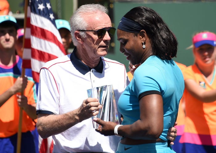Moore presents the second place trophy to Williams after the women's final of the BNP Paribas Open at the Indian Wells Tennis Garden in Indian Wells, California on Sunday.