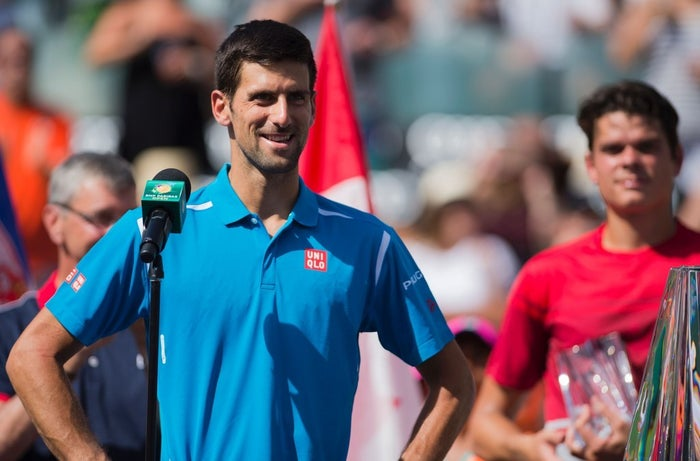 Novak Djokovic of Serbia speaks to the crowd post his win.