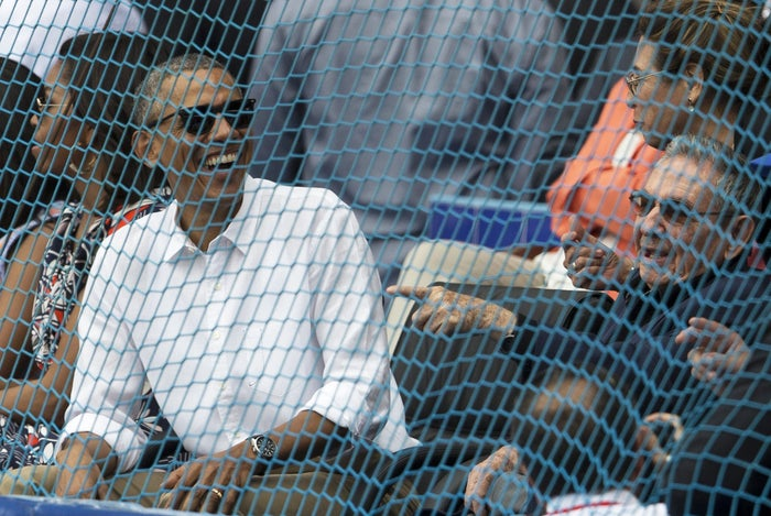 Obama with Cuban President Raul Castro, right, at a baseball game in Havana Tuesday.